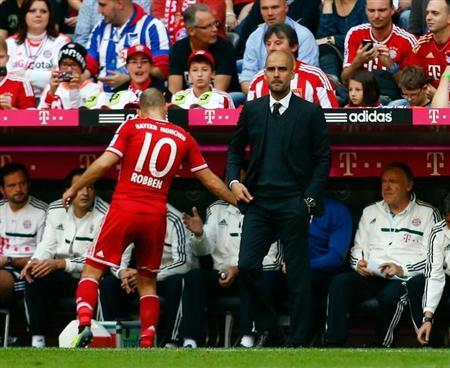 Munich's Arjen Robben leaves the pitch after he was substituted during their German first division Bundesliga soccer match against Hertha Berlin in Munich