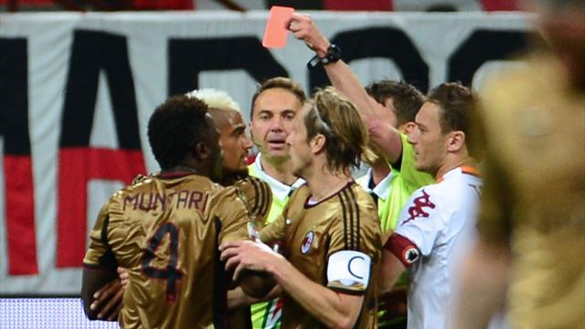 Serie A - Muntari roughs up ref, racist fans stop play