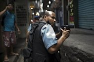 Paramilitary police personnel patrol an alley during a raid at Rocinha shanty town in Rio de Janeiro, Brazil, on September 14. Brazilian authorities stepped up a pacification drive in Rio's largest shantytown Thursday, nearly doubling the police presence in a hillside favela overlooking the city's most famous beaches