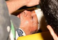 Suffering head injuries, Pakistani politician Imran Khan is rushed to hospital in Lahore on May 7, 2013, after he fell off a lift carrying him onto a stage at an election rally
