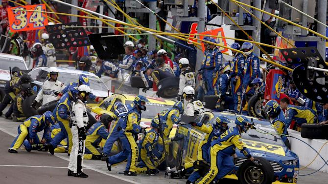 From right, Ricky Stenhouse Jr., Bobby Labonte and David Ragan take a pit stop during the NASCAR Sprint Cup Series auto race, Sunday, March 3, 2013, in Avondale, Ariz. (AP Photo/Matt York)