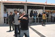 A handout picture released by the official Syrian Arab News Agency (SANA) shows some of the inmates who were released from Damascus Central Prison on June 11, 2014