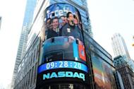 Facebook co-founder Mark Zukerberg is seen on a screen getting ready to ring the NASDAQ stock exchange opening bell in Times Square in New York