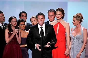 """Doug Savant accepts, with James Denton, Heather Stephens, Eva Longoria, Jesse Metcalfe, Felicity Huffman, Mark Moses, Brenda Strong and Nicollette Sheridan of """"Desperate Housewives"""" Outstanding Ensemble in a Comedy Series Screen Actors Guild Awards - 2/5/2005"""