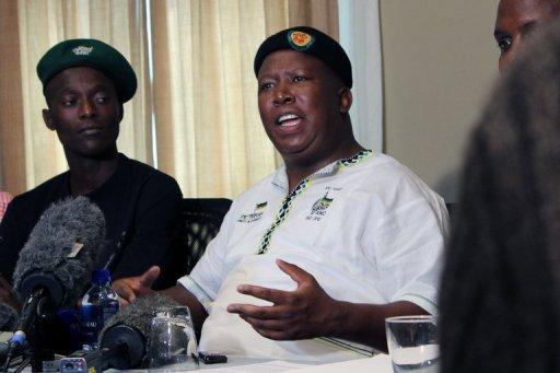 Expelled ANC Youth League president Julius Malema addresses a press conference on September 18. South African elite police have issued an arrest warrant for controversial firebrand Malema, his lawyer confirmed Friday, after media reports linked it to fraud and corruption charges.