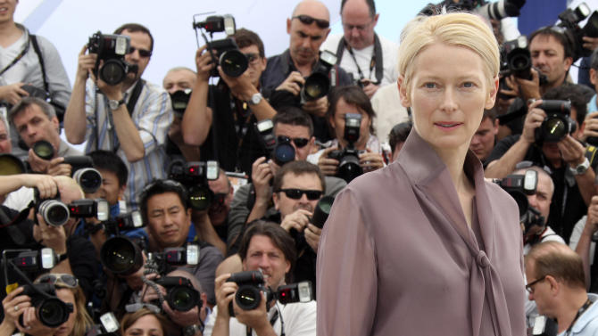 "FILE - In this May 16, 2012,  file photo, actress Tilda Swinton poses during a photo call for Moonrise Kingdom at the 65th international film festival, in Cannes, southern France. Actress Tilda Swinton is performing the art of sleeping at New York City's Museum of Modern Art. A museum spokeswoman says the ""Moonrise Kingdom"" star presented her one-person piece called ""The Maybe"" on Saturday, March 23, 2013. (AP Photo/Joel Ryan, File)"