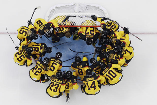 The German women's ice hockey team huddles around the net before their game against Russia during the 2014 Winter Olympics, Sunday, Feb. 9, 2014, in Sochi, Russia. (AP Photo/Matt Slocum )