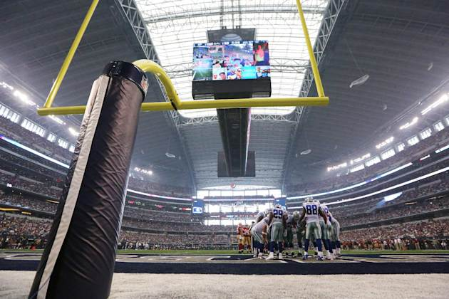 The Dallas Cowboys huddle in the first half of an NFL football game against the San Francisco 49ers, Sunday, Sept. 7, 2014, in Arlington, Texas. (AP Photo/LM Otero)