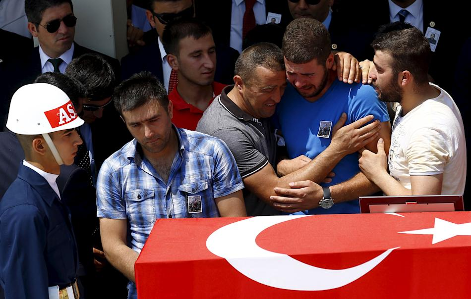 Relatives of slain soldier Hamza Yildirim react during a funeral ceremony at Kocatepe mosque in Ankara