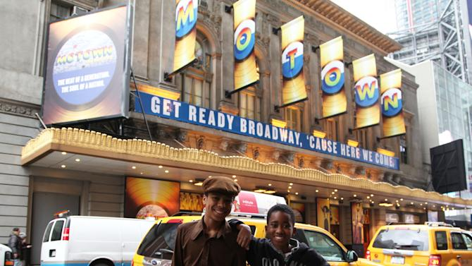 "This March 25, 2013 photo shows actors Jibreel Mawry, left, and Raymond Luke Jr. posing outside the Lunt-Fontanne Theatre in New York, where their show ""Motown: The Musical,"" is playing. The two 12-year-olds are alternating taking on the roles of young Michael Jackson, young Stevie Wonder and a young Berry Gordy. (AP Photo/Mark Kennedy)"