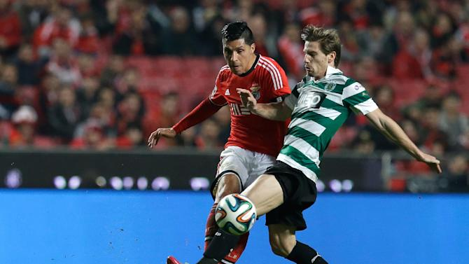 Benfica's Ezequiel Garay, from Argentina, left, fights for the ball with Sporting's Adrien Silva during their Portuguese league soccer match Tuesday, Feb. 11, 2014, at Benfica's Luz stadium in Lisbon