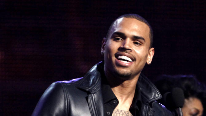 "FILE - In this Feb. 12, 2012 file photo, Chris Brown accepts the award for best R&B album for ""F.A.M.E."" during the 54th annual Grammy Awards in Los Angeles. A judge in Los Angeles ordered a further review of Brown's community service on Monday, Sept. 24, 2012 and set another hearing to determine whether the singer is in compliance with the terms of his probation for the 2009 beating of then-girlfriend Rihanna. (AP Photo/Matt Sayles, File)"