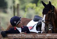 Britain's Zara Phillips, granddaughter of Queen Elizabeth II, talks to her horse, Toytown, in Rome in 2007. Phillips remains in the hunt for a place at the Olympics after a stylish display in the final trial for the London Games on Sunday