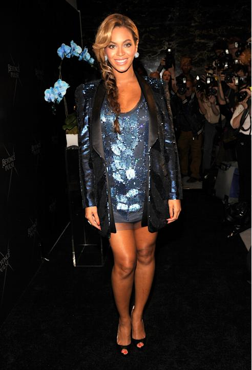 At her fragrance launch in late September, Beyoncé dazzled in a cerulean sequined micro mini dress with a navy sequin-accented blazer on top. (Kevin Mazur/WireImage)