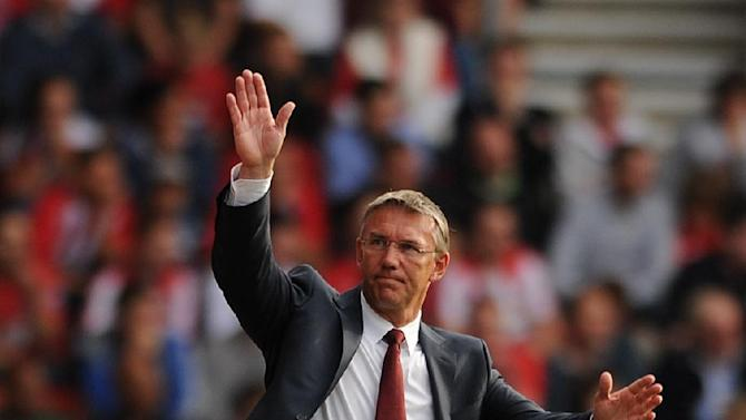 Southampton manager Nigel Adkins waves to the fans during the Barclays Premier League with Aston Villa