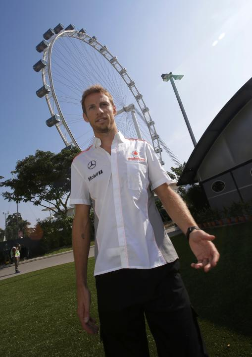 McLaren Formula One driver Button arrives at the track ahead of the first practice session of the Singapore F1 Grand Prix in Singapore