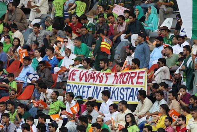 Pakistani cricket fans watch the second one-day international between Pakistan and Zimbabwe at the Gaddafi stadium in Lahore, Pakistan, Friday, May 29, 2015.  (AP Photo/K.M. Chaudary)