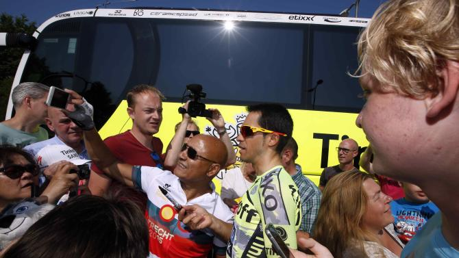 Tinkoff-Saxo rider Alberto Contador of Spain is surrounded by fans before a training session in Utrecht