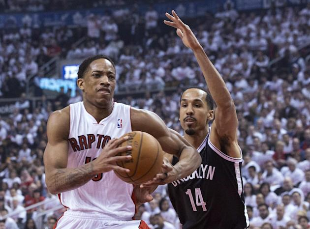 Toronto Raptors' DeMar DeRozan, left, drives on Brooklyn Nets' Shaun Livingston during the first half of Game 1 of an opening-round NBA basketball playoff series, in Toronto on Saturday, April