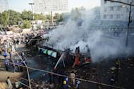 A passenger bus after it exploded in Karachi on Saturday. An explosion on a bus in Pakistan's largest city Karachi Saturday left at least five people dead and wounded 35 others, police said