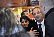 France's Socialist Party candidate for the 2012 French presidential election Francois Hollande (right) is seen at a campaign meeting on April 12 in Clermont-Ferrand. Hollande wants to renegotiate a German-driven fiscal pact that will force nations to enshrine balanced budgets in law, if he is elected in order to insert a growth agenda into the treaty.