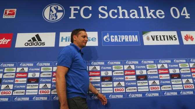 Heldt, manager of Germany's first division Bundesliga soccer first team Schalke 04 arrives for a news conference in Gelsenkirchen