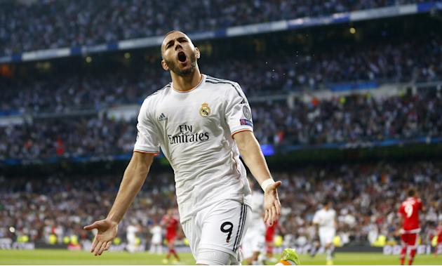 Real's Karim Benzema celebrates scoring the opening goal during a  Champions League semifinal first leg soccer match between Real Madrid and Bayern Munich at the Santiago Bernabeu stadium in Madri