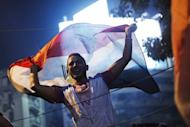 People celebrate at Cairo's Tahrir Square in Egypt on July 3, 2013