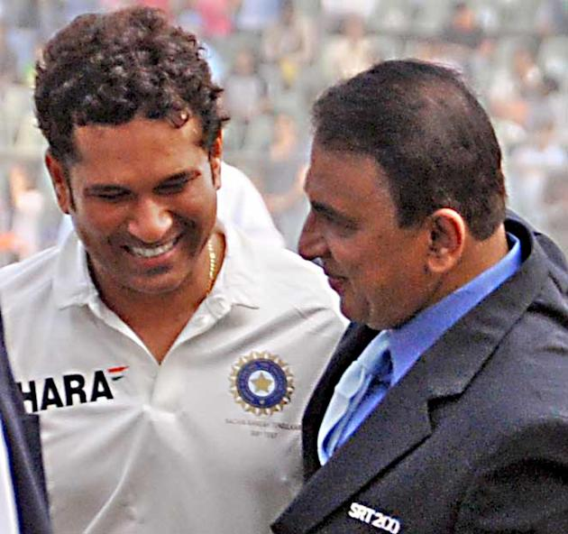 Master blaster Sachin Tendulkar with former Indian Cricketer Sunil Gavaskar ahead of his 200th and the last test match at Wankhede Stadium in Mumbai on Nov.14, 2013. (Photo: Sandeep Mahankal/IANS)