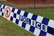 This file illustration photo shows a police tape cordoning off a crime scene near Sydney, in 2011. A two-year-old boy was mauled to death at his grandmother's house in a savage attack by a mastiff cross dog, Sunday afternoon at Deniliquin, in southwestern New South Wales