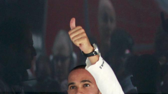 Mercedes Formula One driver Hamilton gives a thumbs up after the qualifying session of the Indian F1 Grand Prix at the Buddh International Circuit in Greater Noida