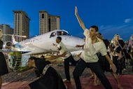 A Brazilian dance group performs during the annual LABACE (Latin American Business Aviation Conference and Exhibition) at Congonhas Airport, in Sao Paulo, Brazil on August 16. The major air show this week turned the spotlight on the robust health of Brazil's general aviation market, which is thriving despite the global economic slowdown
