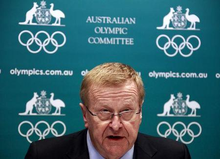FILE PHOTO - John Coates announces the findings of a probe into the conduct of Australia's swimming team members in the run-up to the 2012 London Games, at a media conference in Sydney