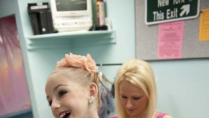 """Christi helps her daughter Chloe get ready for a performance in """"Dance Moms."""""""