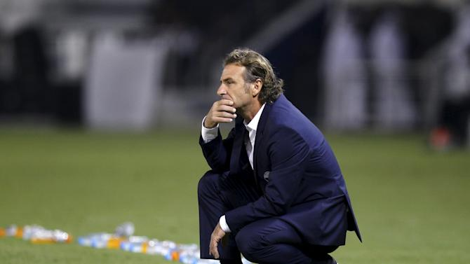 Qatar's team coach Carreno looks on during the 2018 World Cup qualifying soccer match against China in Doha