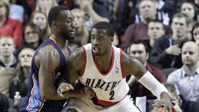 Portland Trails Blazers guard Wesley Matthews, right, works the ball in on Charlotte Bobcats guard Kemba Walker during the first half of an NBA basketball game in Portland, Ore., Thursday, Jan. 2, 2014