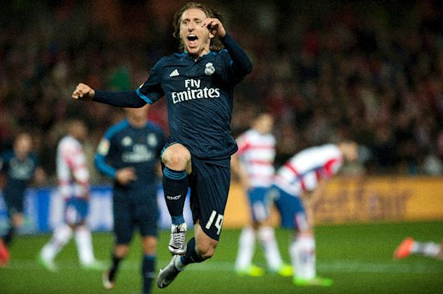 Real Madrid's midfielder Luka Modric celebrates a goal during a Spanish league football match against Granada at Nuevo Los Carmenes stadium in Granada on February 7, 2016