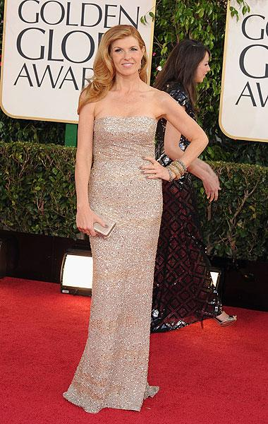 Connie Britton: We are huge fans of Connie Britton over here at Shine Canada. We loved her as Tami Taylor in 'Friday Night Lights' and now as country superstar Rayna James on 'Nashville.' So it's always a pleasure to see her on the red carpet and she doesn't disappoint in this beautifully understated column dress. From far away it looks like a sparkle-nude colour but up close, you can see the orange-red stripes, giving the dress some dimension. She looks stunning. (Photo by Steve Granitz/WireImage)