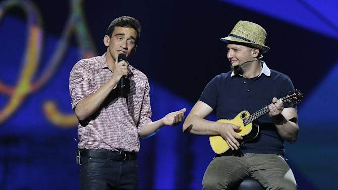 "Gianluca of Malta performs his song ""Tomorrow"" with his band during a rehearsal for the final of the Eurovision Song Contest at the Malmo Arena in Malmo, Sweden, Friday, May 17, 2013. The contest is run by European television broadcasters with the event being held in Sweden as they won the competition in 2012, the final will be held in Malmo on May 18. (AP Photo/Alastair Grant)"