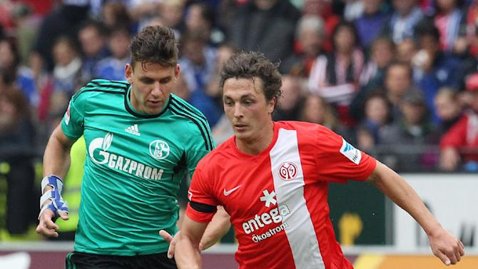 Mainz's Julian Baumgartlinger of Austria, right, and Schalke's Adam Szalai of Hungary challenge for the ball during a German Bundesliga  soccer match between FSV Mainz 05 and FC Schalke 04 in Mainz, Germany, Saturday, Sept. 14, 2013