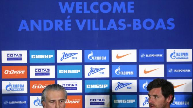 Zenit St.Petersburg's new head coach Villas-Boas and Gazprom Neft CEO Dyukov attend a news conference in St.Petersburg