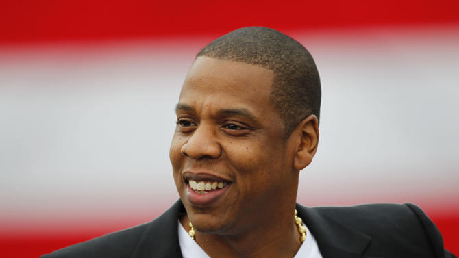 "FILE - In this May 14, 2012 file photo, entertainer Shawn ""Jay-Z"" Carter smiles during a news conference at the Philadelphia Museum of Art in Philadelphia. Jay-Z will perform the first of eight shows at the newly built Barclays Center in Brooklyn on Friday night, Sept. 28, 2012. The rapper is the co-owner of the Brooklyn Nets, who will play the new arena this year. (AP Photo/Matt Rourke, File)"