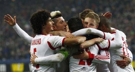 FC Salzburg's Jonatan Soriano (3rd L) celebrates with team mates their team's goal against Ajax Amsterdam during their Europa League soccer match in Salzburg February 27, 2014. REUTERS/Michaela Rehle/Files