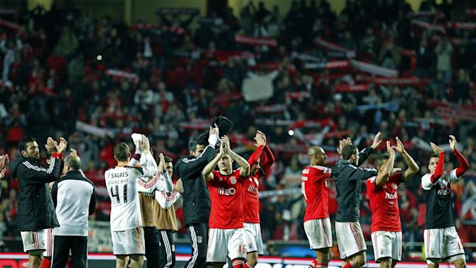 Benfica's players acknowledge supporters at the end of the Portuguese league soccer match between Benfica and Porto at Benfica's Luz stadium in Lisbon, Sunday, Jan. 12, 2014. Ezequiel Garay, left, from Argentina, and Rodrigo, right, from Spain, scored once each in Benfica's 2-0 victory