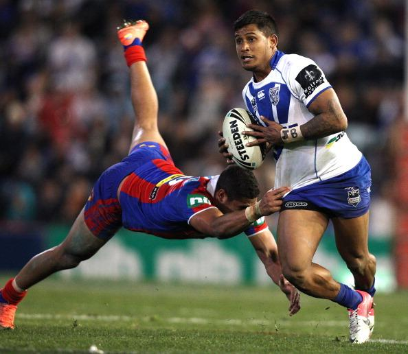 Ben Barba of the Bulldogs breaks clear of Dane Gagai of the Knights during the round 22 NRL match between Canterbury-Bankstown Bulldogs and Newcastle Knights at Hunter Stadium on August 4, 2012 in Newcastle, Australia. (Photo by Tony Feder/Getty Images)