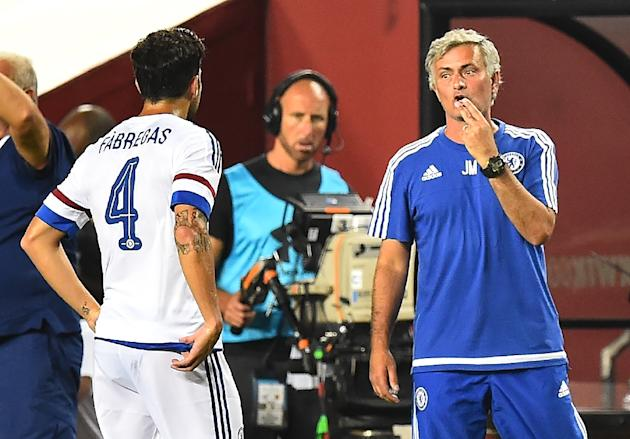 Chelsea coach Jose Mourinho (R) speaks to player Cesc Fabregas during an International Champions Cup match in Landover, Maryland, on July 28, 2015