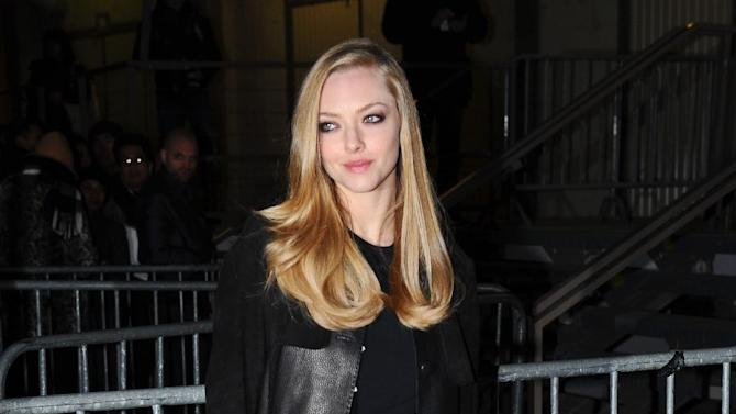 Actress Amanda Seyfried arrives at Givenchy's Ready to Wear's Fall-Winter 2013-2014 fashion collection presented Sunday, March 3, 2013 in Paris. (AP Photo/Zacharie Scheurer)
