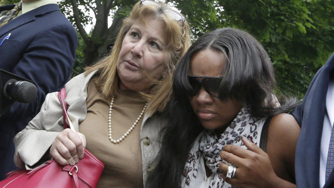 Shayanna Jenkins, right, fiancee of former New England Patriots football player Aaron Hernandez, is escorted by attorney Janice Bassil after a bail hearing in Fall River Superior Court Thursday, June 27, 2013 in Fall River, Mass. Hernandez, charged with murdering Odin Lloyd, a 27-year-old semi-pro football player, was denied bail. (AP Photo/Elise Amendola)