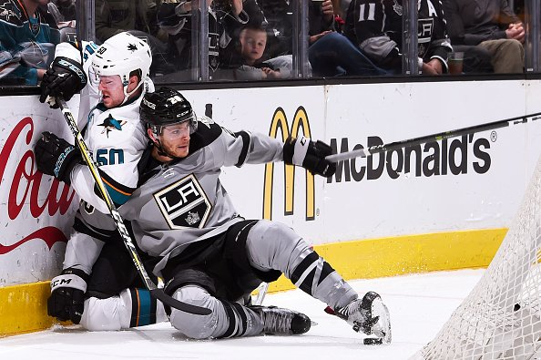 LOS ANGELES, CA - DECEMBER 31: Nic Dowd #26 of the Los Angeles Kings battles for the puck against Chris Tierney #50 of the San Jose Sharks during the game on December 31, 2016 at Staples Center in Los Angeles, California. (Photo by Juan Ocampo/NHLI via Getty Images)