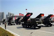 North Korean soldiers ride on the back of MLRS (mutliple launch rocket system) vehicles during a military parade in Pyongyang on April 15, 2012. North Korea has apparently finished preparations for a third nuclear test at its underground site at Punggye-ri, in the northeast of the country, according to South Korean nuclear experts